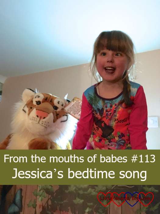 """Jessica sitting on the top bunk next to a large toy tiger in the hotel at Chessington - """"From the mouths of babes #113 - Jessica's bedtime song"""""""