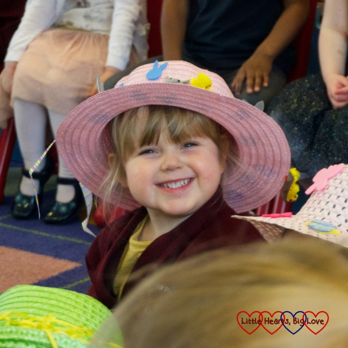 Sophie wearing her Easter bonnet and giving me a big smile during her preschool Easter concert
