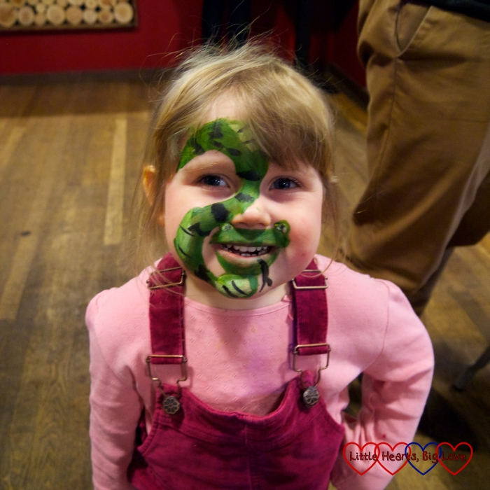 Sophie with her face painted as a snake