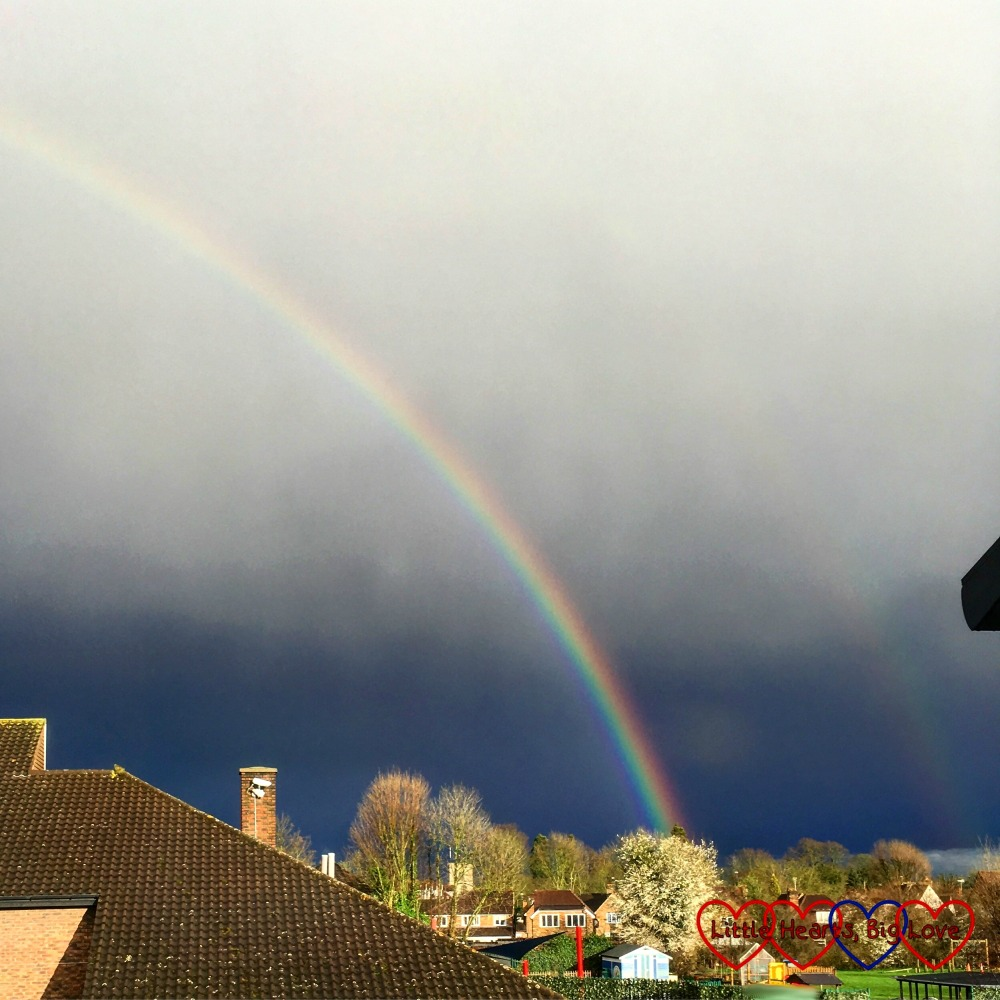 A beautiful rainbow seen through a window