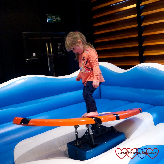 Sophie trying out some surfing