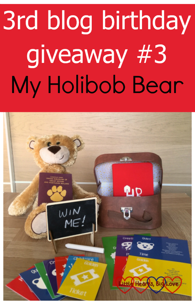 "A My Holibob Bear with suitcase, chalkboard and chalk, activity cards, journal and Pawsport. The chalk board has a message that says ""Win me"" and the text at the top reads ""3rd blog birthday giveaway #3 - My Holibob Bear"""