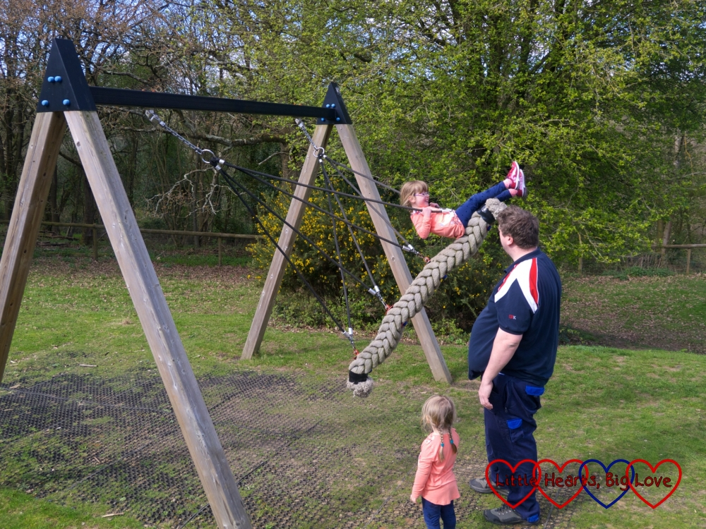 Jessica being pushed high in the air on the swing - she's swinging just above hubby's head height (6ft 3in) in this shot