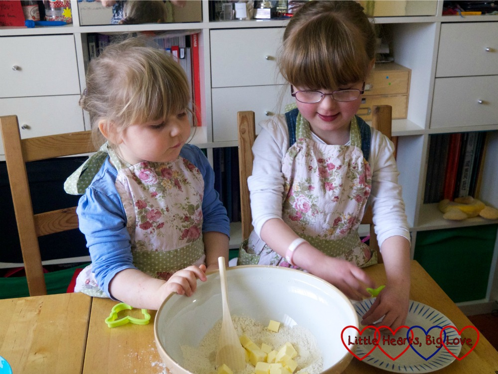 Sophie and Jessica adding the butter to the bowl