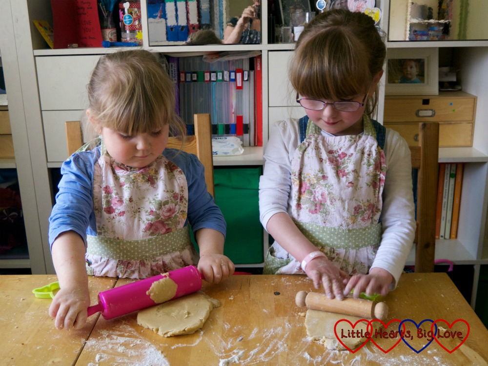 Sophie and Jessica rolling out the dough