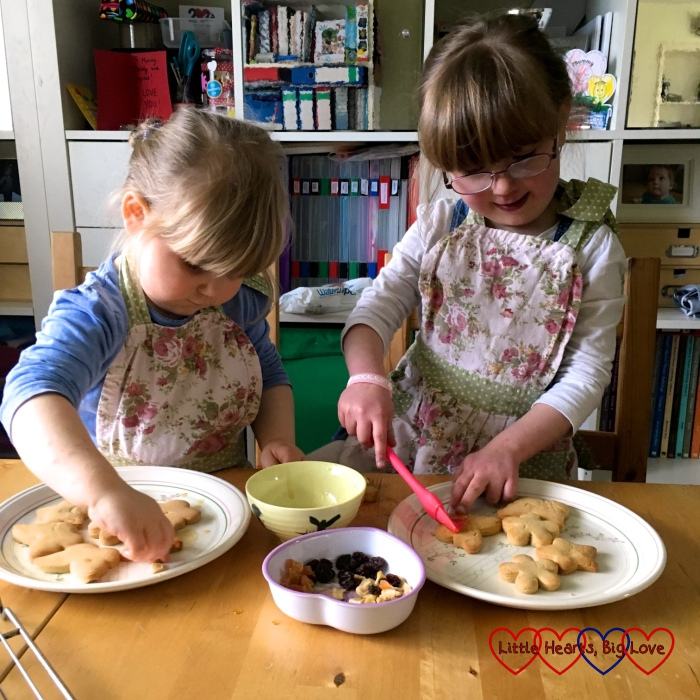 Jessica and Sophie decorating the biscuits
