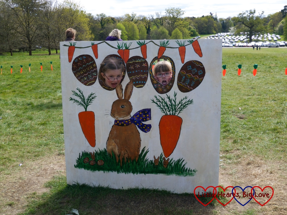 Jessica and P standing behind the bunny rabbit cut-out at Cliveden