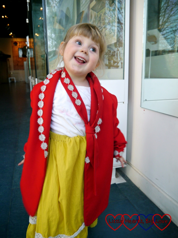 Sophie dressing up in a red blazer and yellow Edwardian skirt