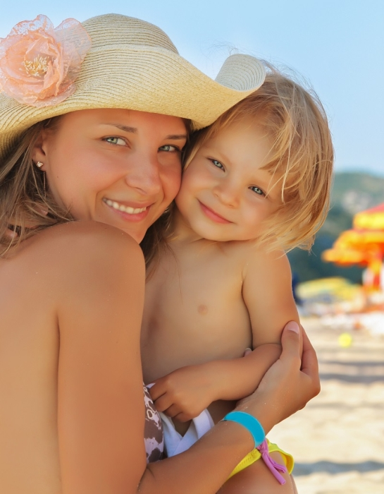 Jenny from Mom Loves Best with one of her children at the beach