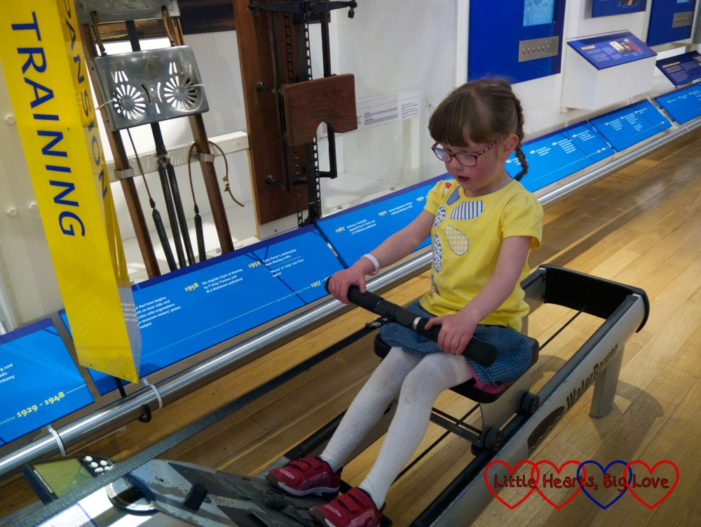Jessica having a go on a rowing machine