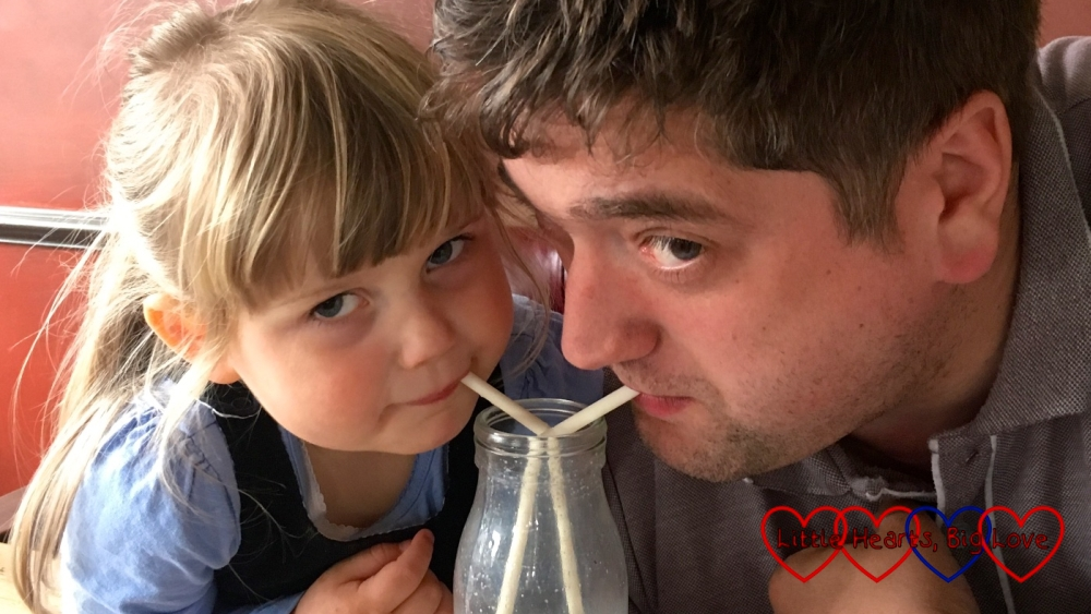 Sophie and her daddy sharing a milkshake