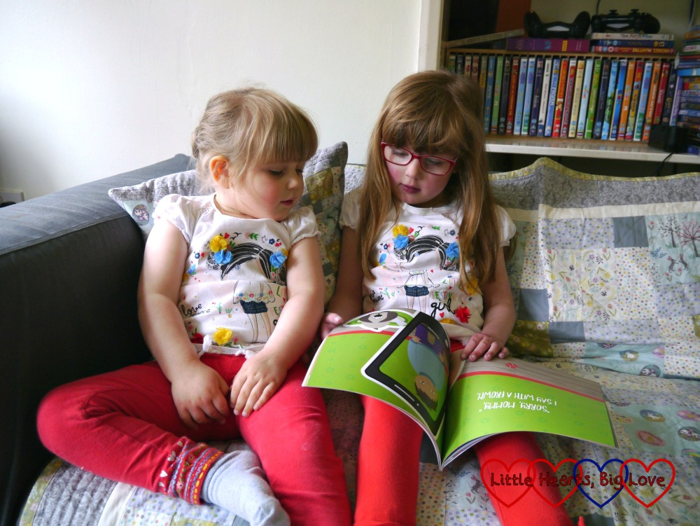 Jessica and Sophie sitting on the sofa reading #BabyLove: My Toddler Life