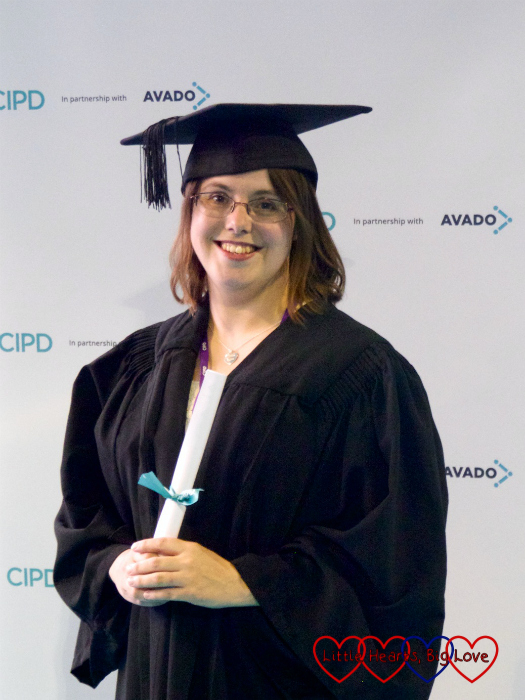 Me wearing cap and gown at my CIPD graduation ceremony