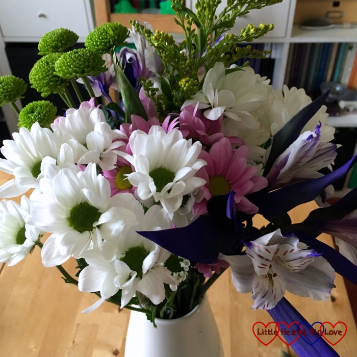 A bouquet of white and purple flowers
