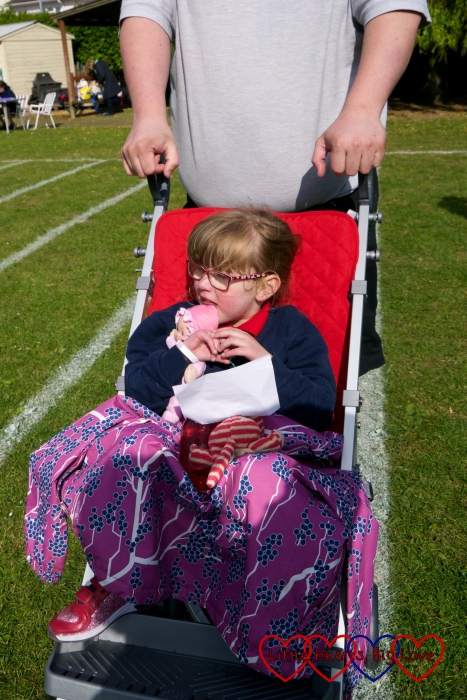 Jessica sitting in her buggy after her Sports Day