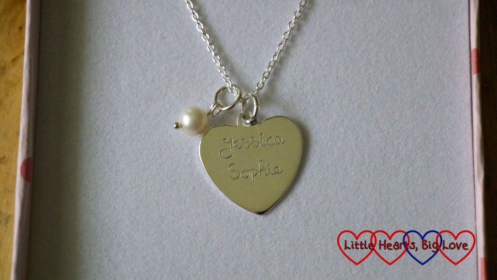 "A heart-shaped pendant with ""Jessica"" and ""Sophie"" engraved on it"