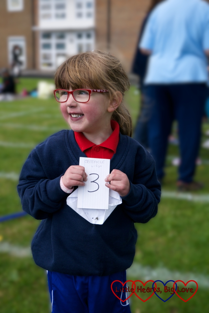Jessica with her 3rd place ticket for the obstacle race at her Girls' Brigade sports day