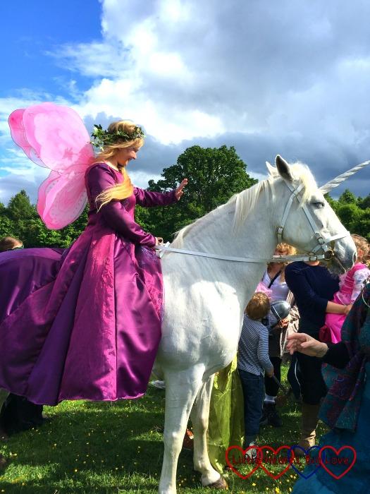 A fairy princess riding a unicorn
