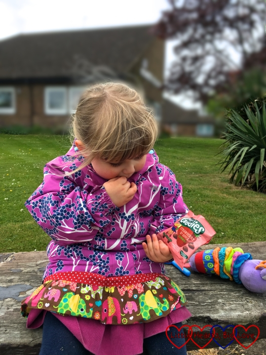 Sophie eating some Organix Goodies fruit gummies while out and about