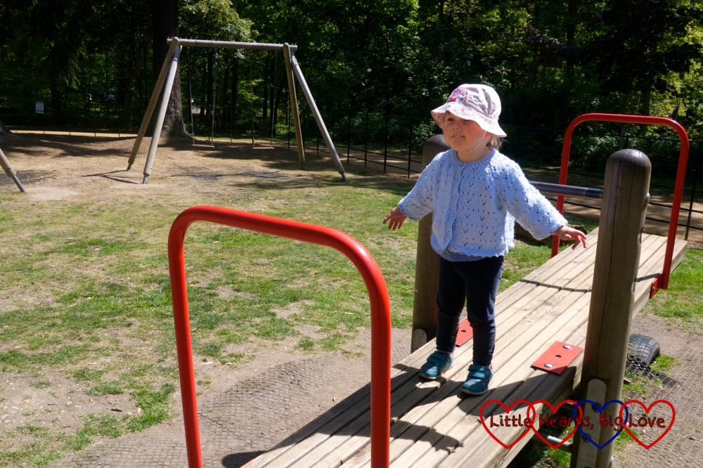 Sophie on the seesaw at Langley Park