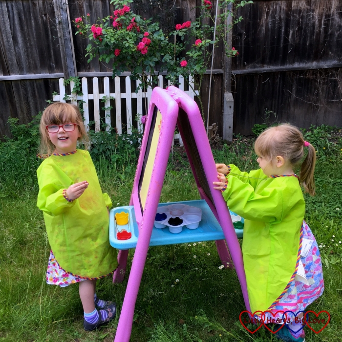 Jessica and Sophie at their easel in the garden