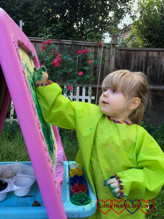 Sophie painting with her fingers