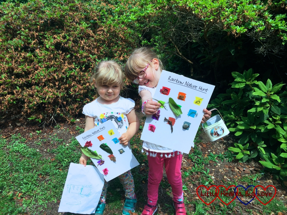 Jessica and Sophie with their completed rainbow nature hunt sheets