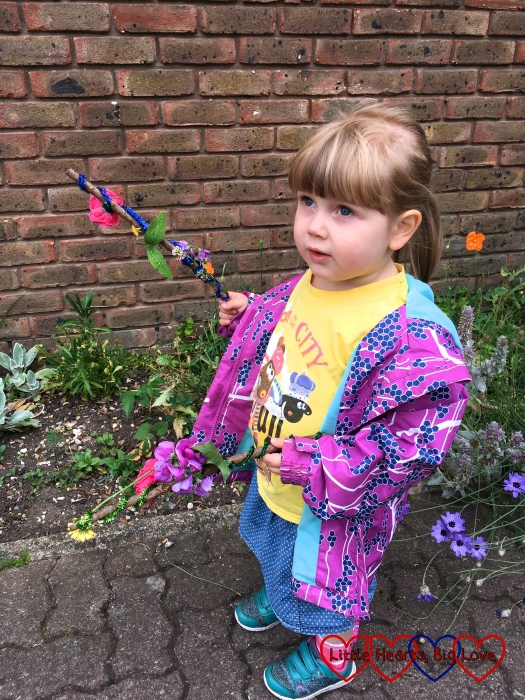 Sophie holding two fairy wands