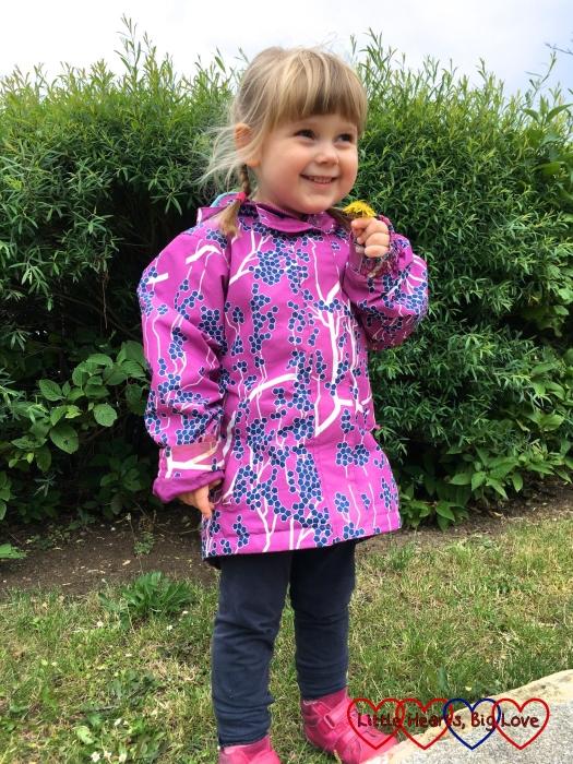 Sophie holding a dandelion