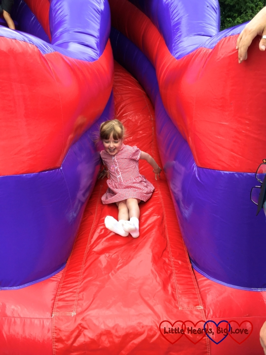 Jessica sliding down the inflatable helter-skelter