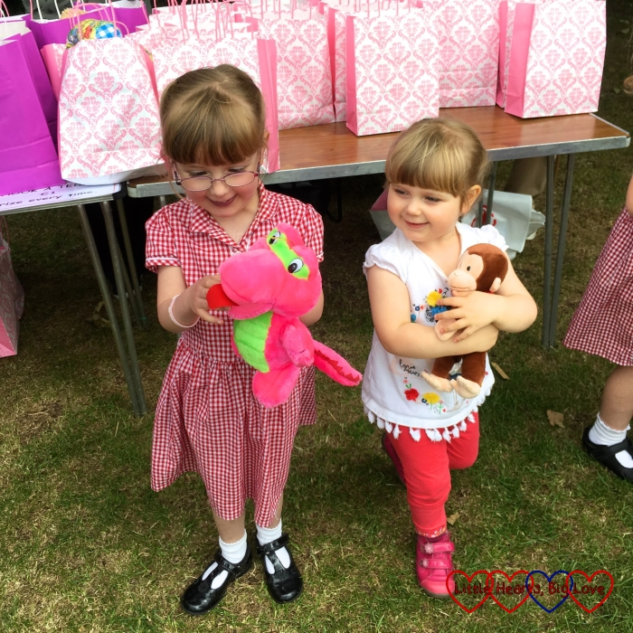 "Jessica and Sophie with their cuddly toys from the ""hook a teddy"" stall"