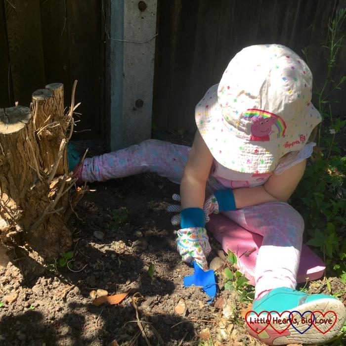 Sophie digging in the garden