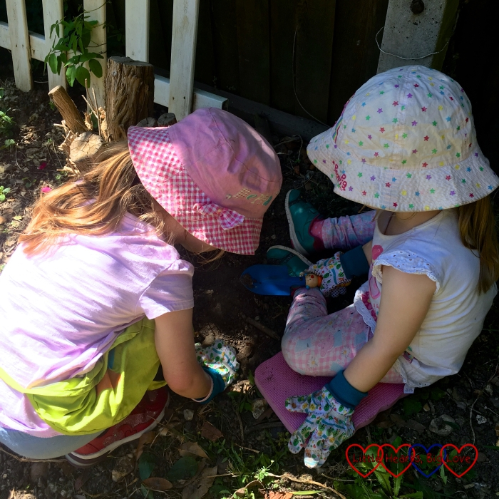 Jessica and Sophie looking at insects in the garden