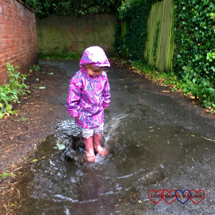 Sophie jumping in puddles