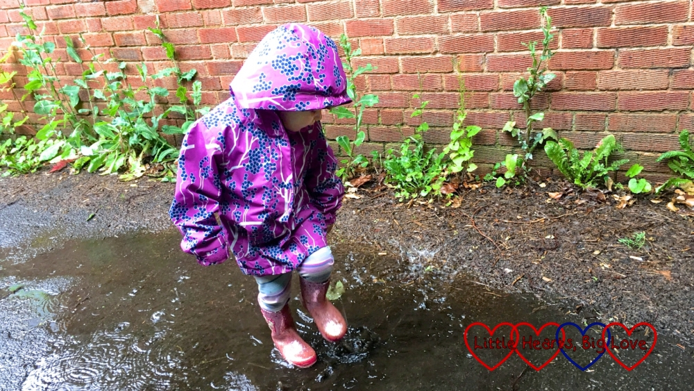 Sophie jumping in a puddle