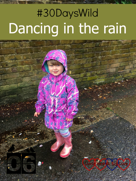 """Sophie standing in a puddle in the rain - """"#30DaysWild - Dancing in the rain"""""""