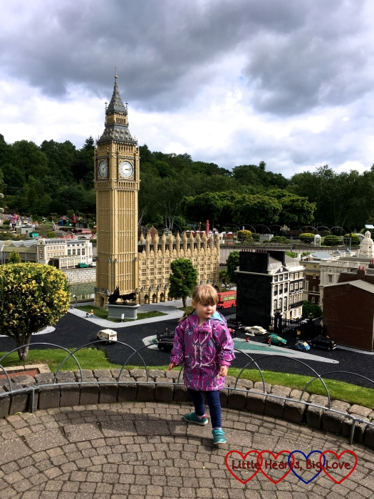 Sophie standing by the Big Ben model in Miniland