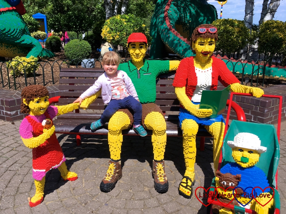 Sophie posing with a Lego family