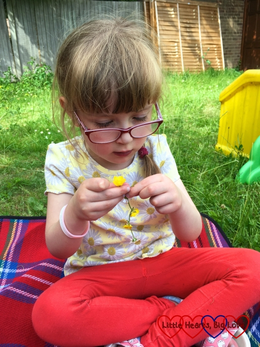 Jessica concentrating on threading the daisy through the stem