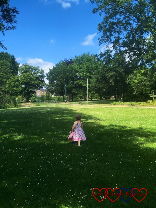 Sophie exploring Herschel Park in the sunshine