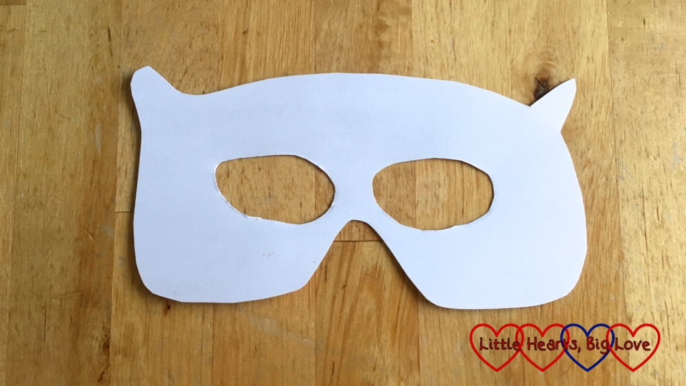 The mask shape cut out of white cardboard