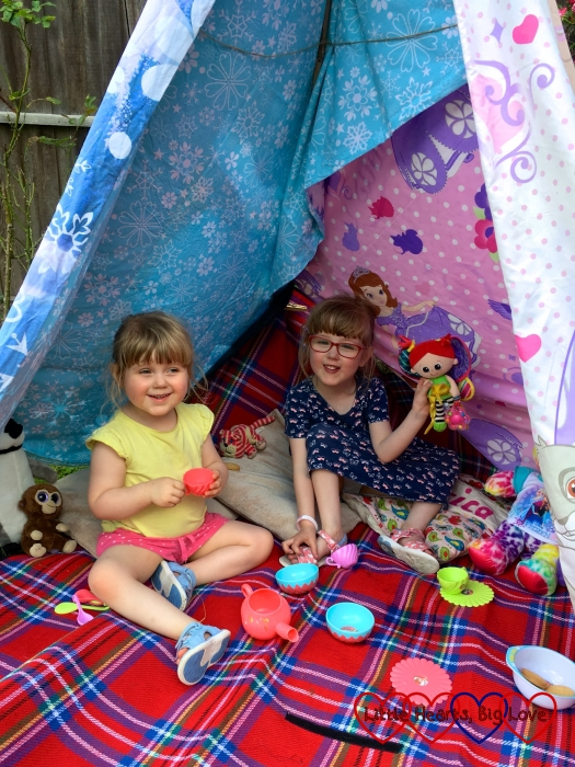 Jessica and Sophie enjoying a tea party inside the tepee