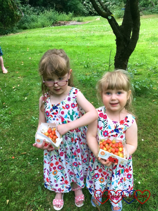 Jessica and Sophie with their trays of cherries
