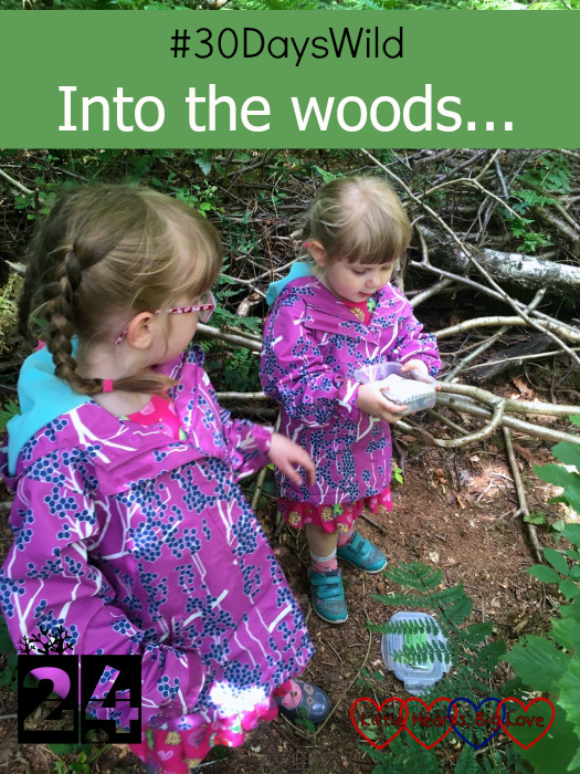 "Sophie and Jessica holding a geocache in the woods - ""#30DaysWild - Into the woods..."""