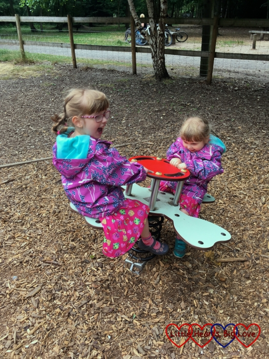 Sophie and Jessica playing in the playground