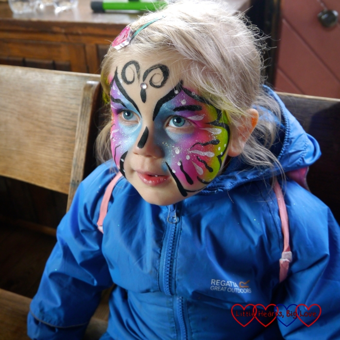 Sophie with rainbow butterfly face paint