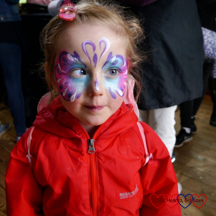 Jessica with pink and purple butterfly face paint