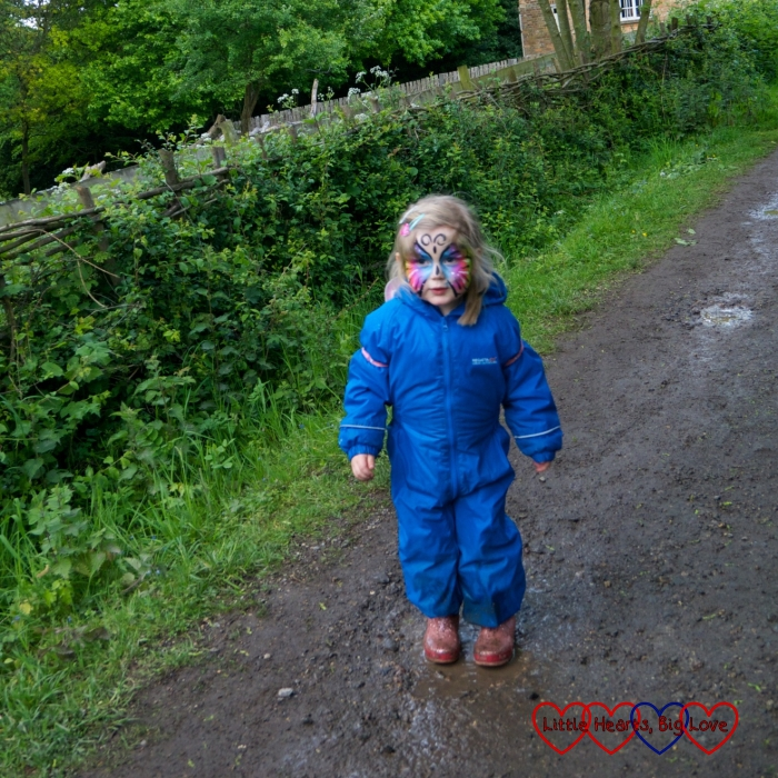 Sophie jumping in muddy puddles