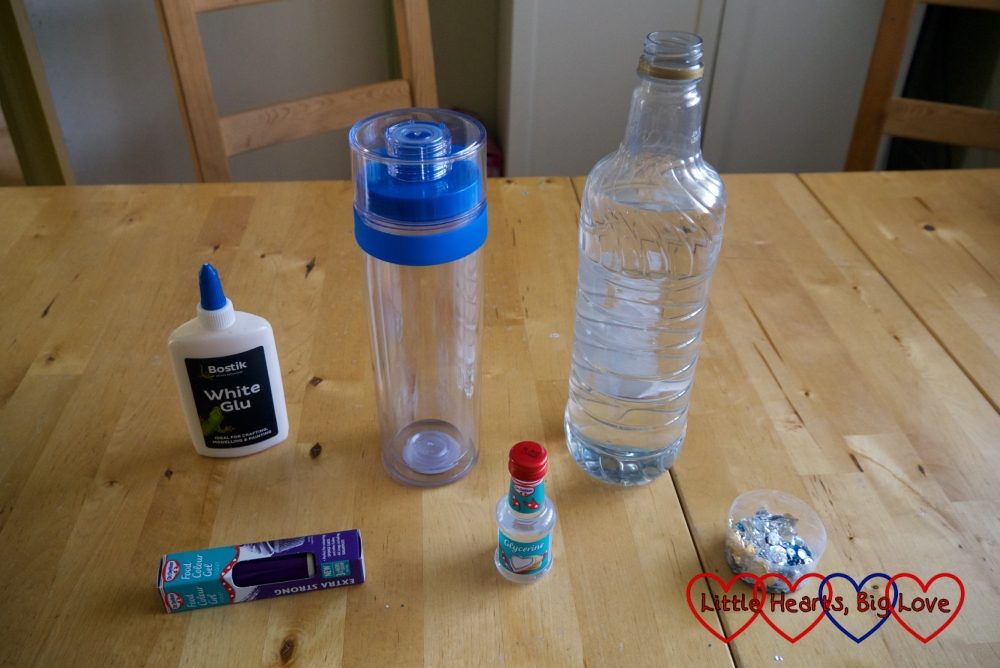 Bostik White Glu, two clear plastic bottles, purple food colouring, glycerine and a tub of sequins laid out on a table
