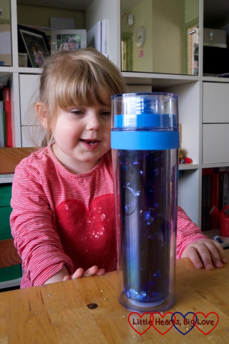 Sophie looking at her starry night glitter jar